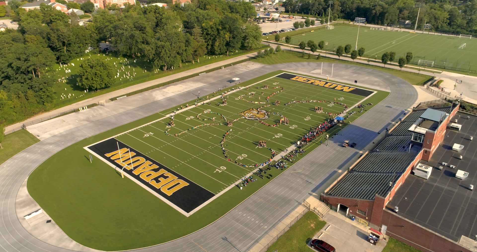 drone view of band camp practicing on Nick Mourouzis Field