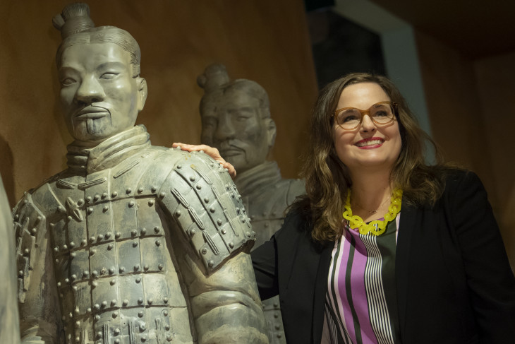 Jennifer Pace Robinson stands with Chinese warrior statues.