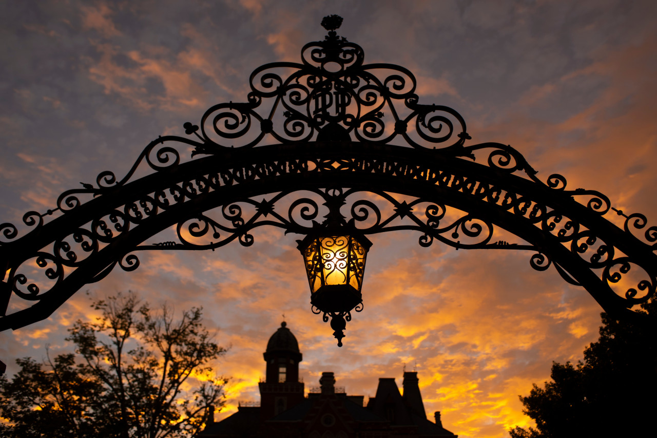 DePauw arch and lantern at sunset