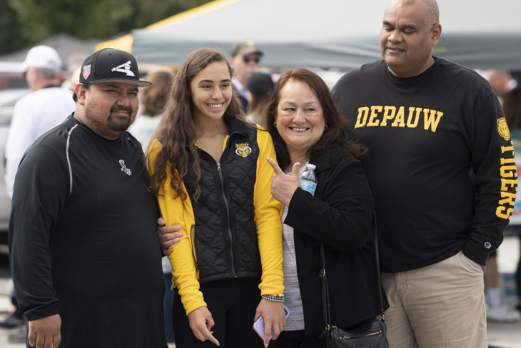 Old Gold tailgate; student with her family in DePauw gold & black