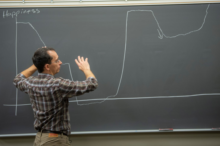 Professor Jacob Hale stands at a chalkboard