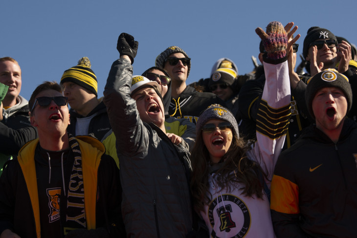 students cheering at a football game