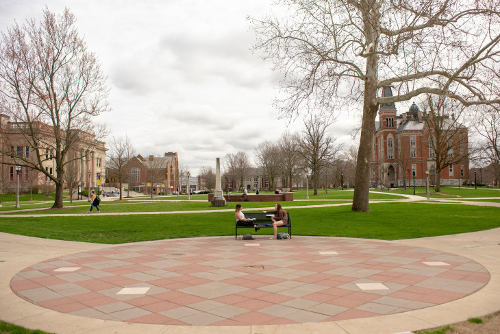 students sitting in academic quad