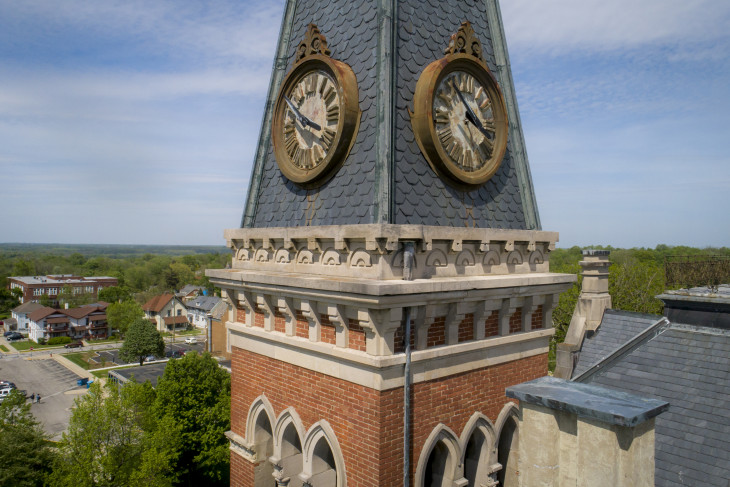 The clock tower in the foreground of a drone shot