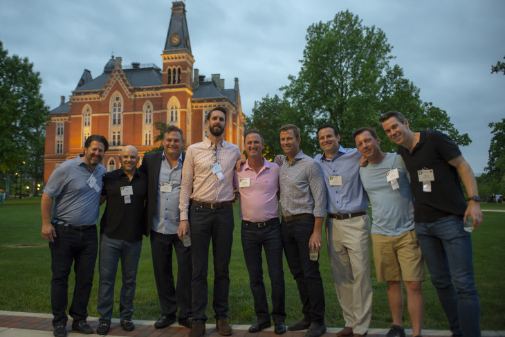 Alumni standing in east college lawn