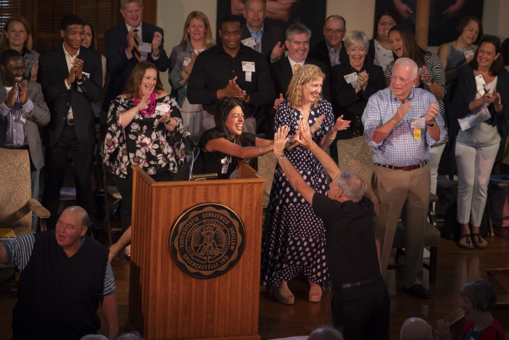 Alumni on stage celebrating at Alumni Reunion Weekend