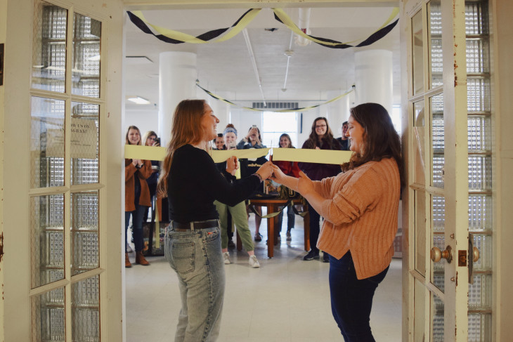 Students cut the ribbon during the grand re-opening of the Thrifty Tiger store.