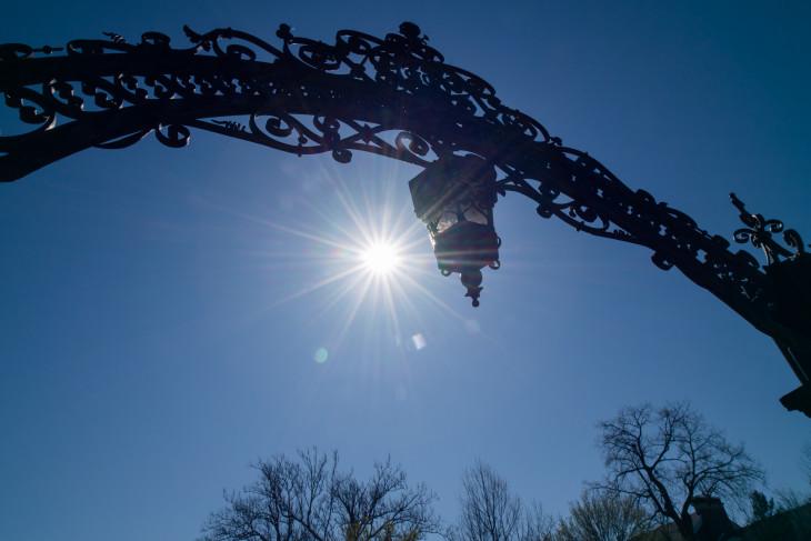 Sun behind the arch