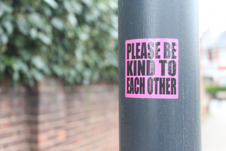 be kind sign on post