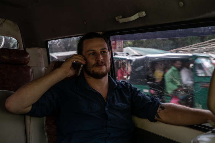 Ben Solomon on the phone in a car in Rohingya