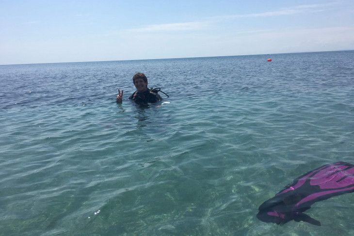 Caleb floating in the water
