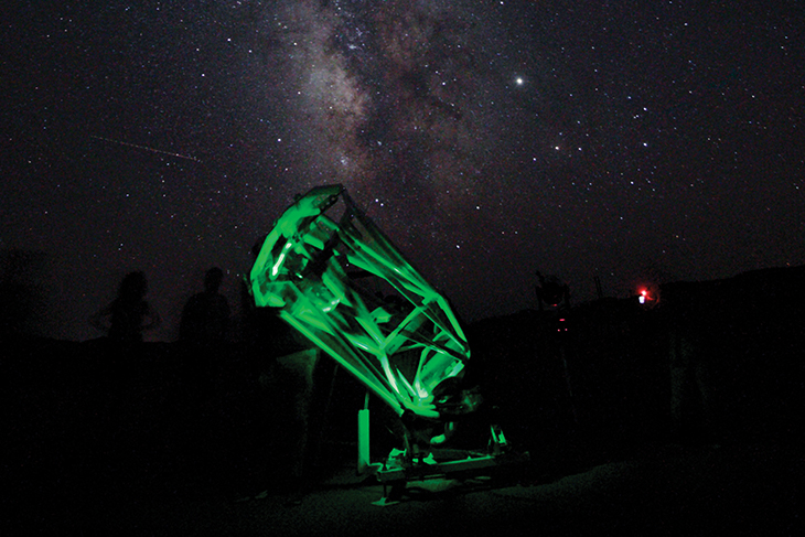 The University of Utah's Stout Scope, a traveling outreach telescope, silhouetted against the dark sky into which it peers. Photo by Paul Ricketts.