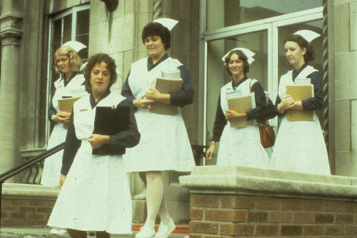 Nurses walking down outdoor stairs