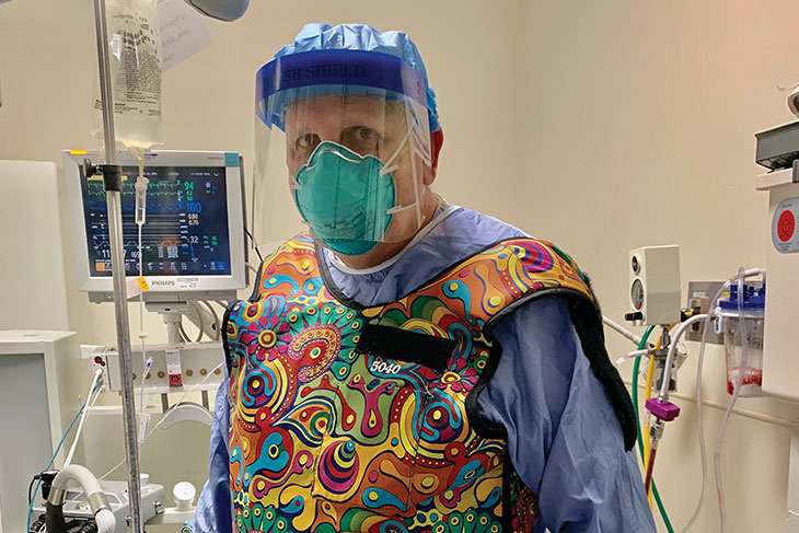 Tom Mote in PPE in a hospital room
