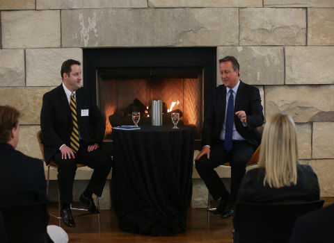 History Professor Robert Dewey conducting a student forum with former British Prime Minister David Cameron