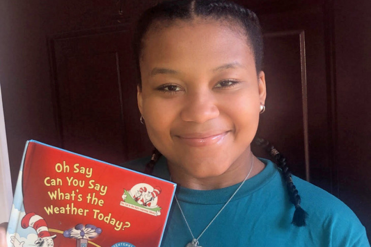 Caria Monroe with children's book