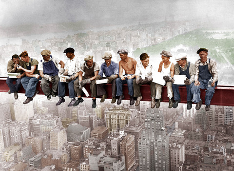 Period photo of construction workers taking a break on a sky scraper beam