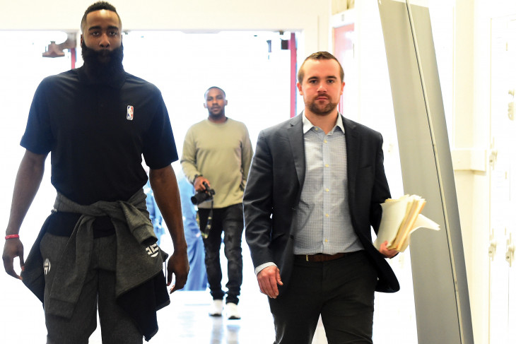 David Dietz (r) escorts Houston Rocket James Harden