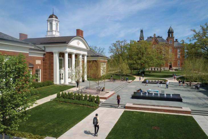 Students walk on sidewalk across campus