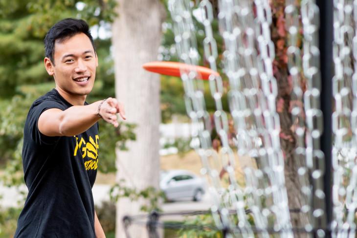 Student plays disc golf