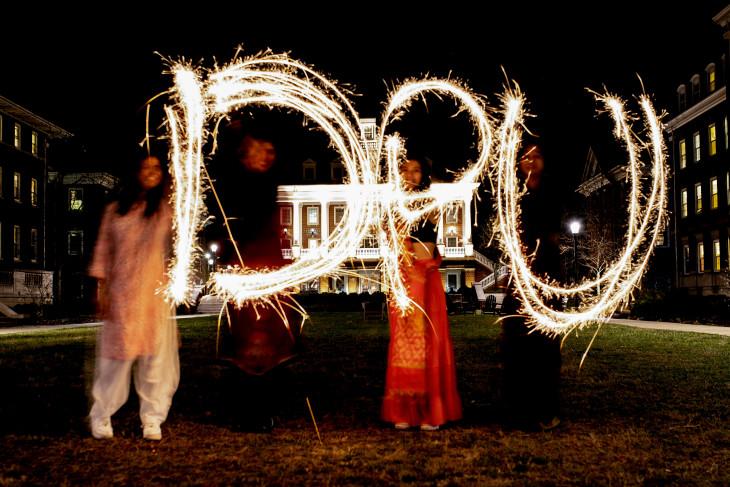 Celebrants of Diwali write DPU with sparklers