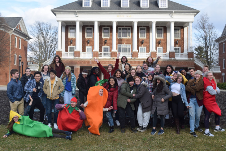 Members of the Sustainability Leadership Program pose in front of Reese Hall