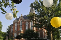 East College with white and gold lanterns in the foreground