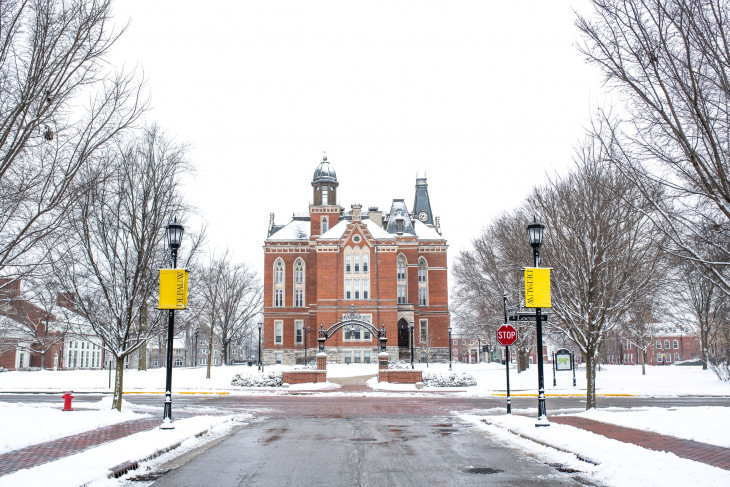 Snowy campus shot featuring East College