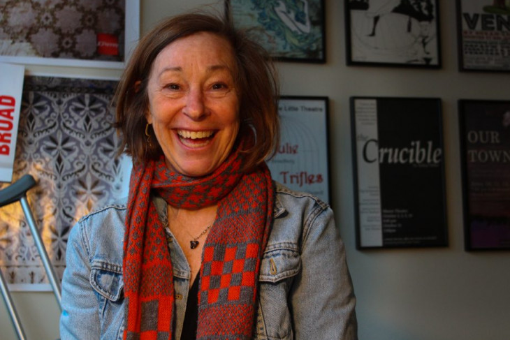 A picture of Gigi Jennewein smiling in her office