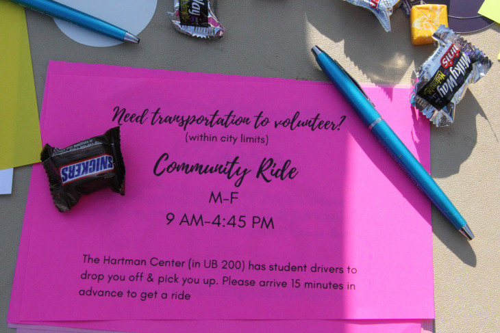 Pink flyer with community ride details and candy and pens