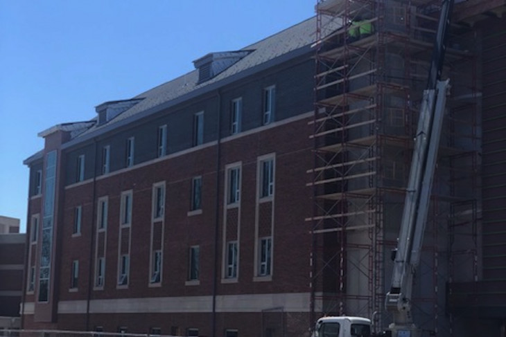 Outside photo showing work on the exterior of residence hall 1