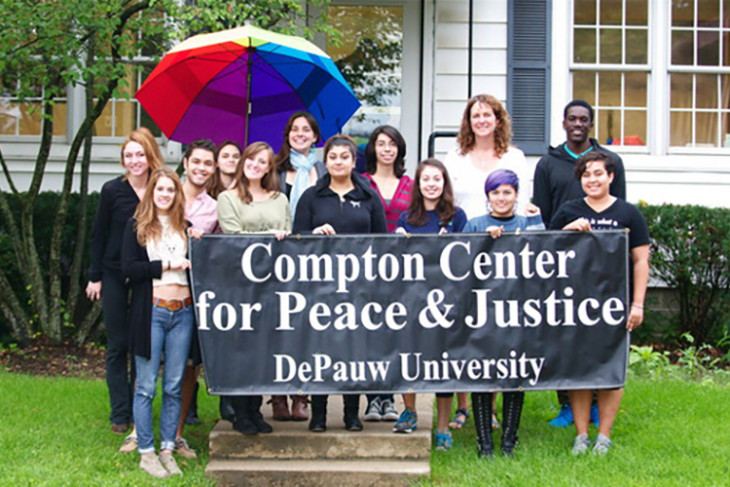 DePauw University students with Compton Center for Peace & Justice banner