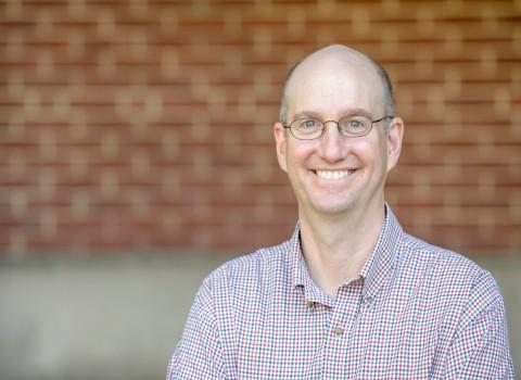 David Gellman headshot with brick background
