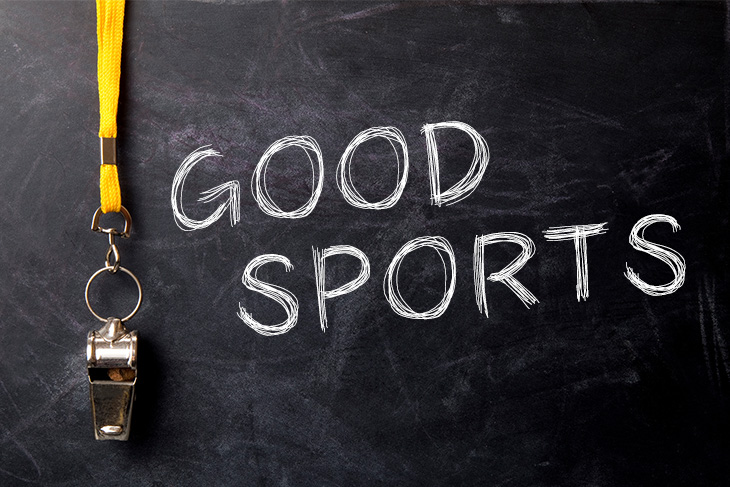 """Whistle on black background beside text that says """"Good Sports"""""""