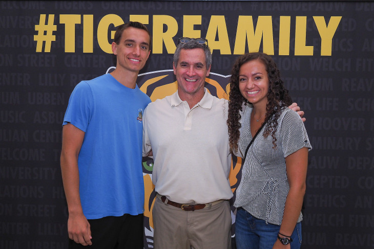 Family standing in front of a #TigerFamily backdrop