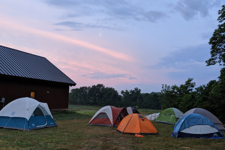 Sun sets over tents at the Ullem Center.
