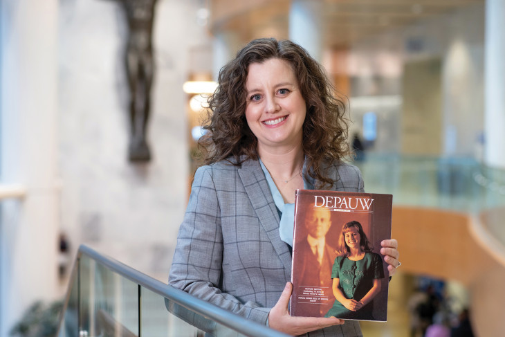 Erin O'Brien '96 holding the DePauw Magazine with her on the cover