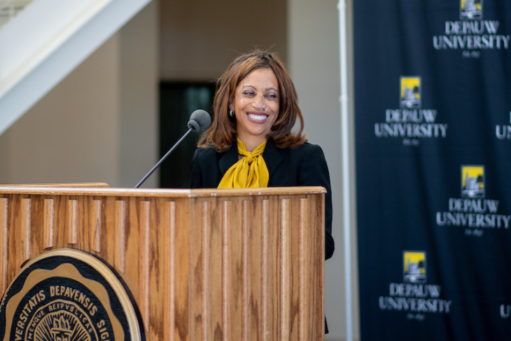 President White stands at a lectern during her official welcome to campus.