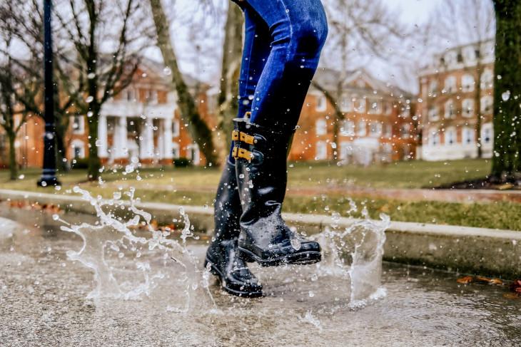 Water splashing as a woman skips through it