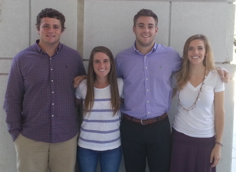 Cody Campbell '17, Brooke Hasler '16, Charlie Roberts '16, and Maureen Bailey '16 at Global Top 100 in Business Simulator