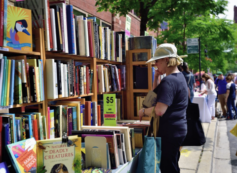 A woman ponders making a purchase at the Printers Row Lit Fest in Chicago. (Bruce Leighty /Alamy Stock Photo)