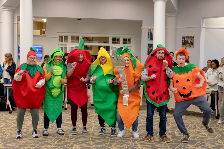 Students dance in vegetable costumes.