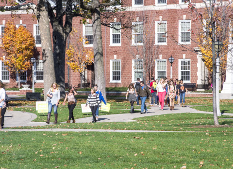 Students outside Asbury Hall in the fall.