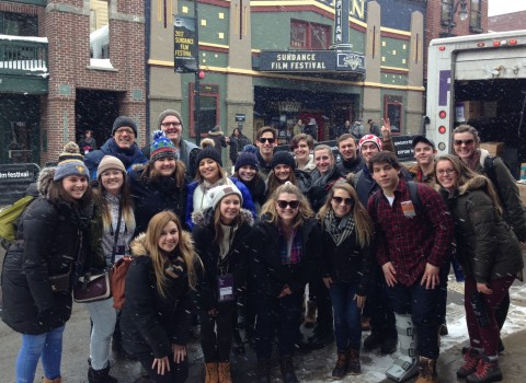 Professors Graham and Wright posing with Winter Term students in front of the 2017 Sundance Film Festival