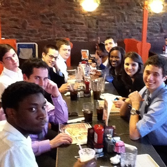 """The DePauw Debate team chills after rounds at the 2012 BGSU tournament.  Robert McMurray received the honorary """"Big Boy"""" trophy."""