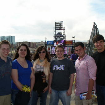 """Avery Archer, Christine Walker, Keelin Kelly, Aaron Dicker, Jimmy Kirkpatrick, and Sam Holley-Kline (left to right) enjoy the """"High Life"""" at a Colorado Rockies game after rounds at the 2010 USU National Tournament at the University of Denver."""