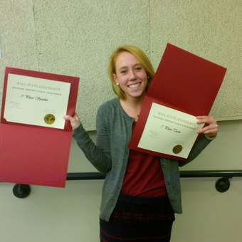 Erin Mann flashes her awards after her successful first collegiate debate tournament at Ball State University (2014).