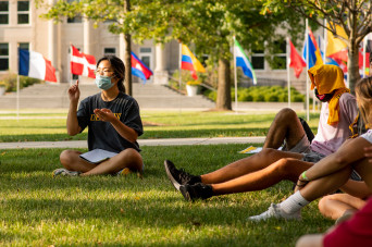 Students sitting outside during new student welcome session