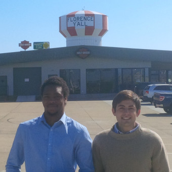 """Danny Schultz and KeVeon White strike a pose under Danny's hometown """"Florence Y'all"""" Watertower after the Gateway Debate Tournament (2017)."""