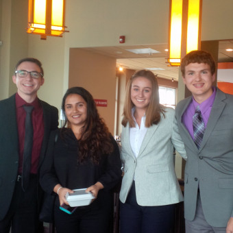 The Debate Team takes it to the bridge after rounds of the Audrey Cunningham Forensic 500 Tournament.  Pictured (left to right): Liam Byrnes, Rajshree Upadhyay, Brenna Milligan, Alex Spencer (2018).